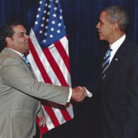 Juan LaFonta shaking hands with Former President Barack Obama